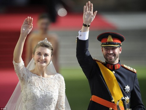 Princess Stephanie and Prince Guillaume wave to the crowd from the balcony after the wedding ceremony